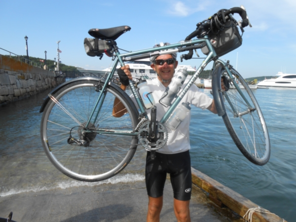 Shular Lifting his bicycle at the pier in Bar Harbor, Maine